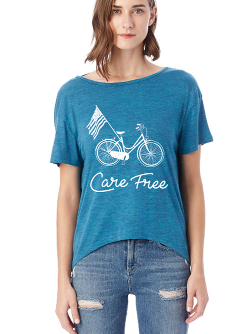 the admiral's daughters care free blue open back flowy t-shirt with bicycle beach cruiser and american flag