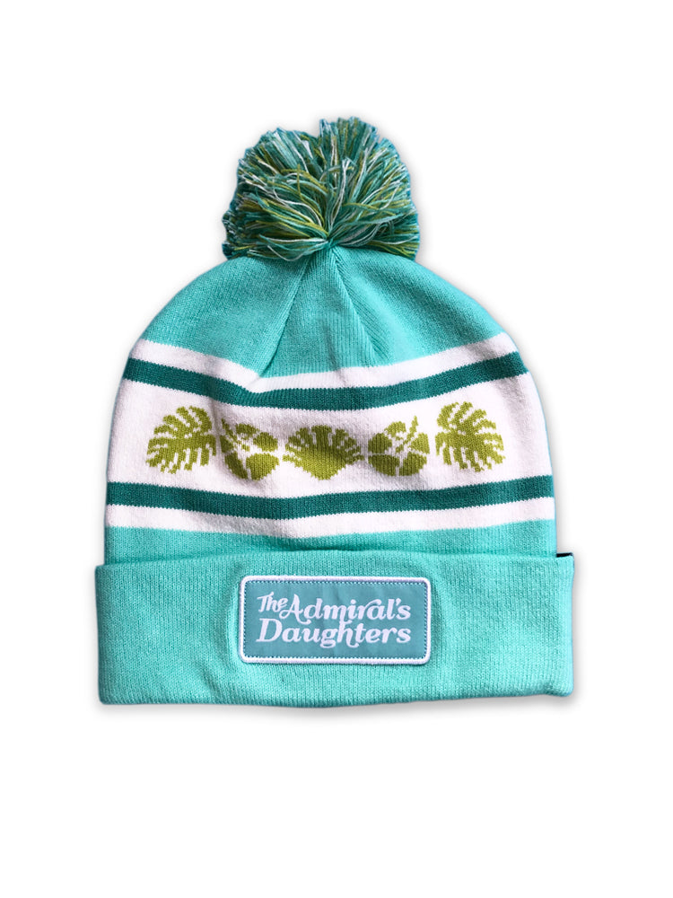 The Admiral's Daughters teal sea side pom pom knit beanie with sea shells and patch hibiscus flowers palm leaves