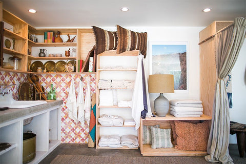 "Shelves are stacked with linens from L.A.-based Matteo, a longtime favorite of Channon and Bianca (""We've slept on their sheets since the company began,"" Channon says), and towels by Creative Women."