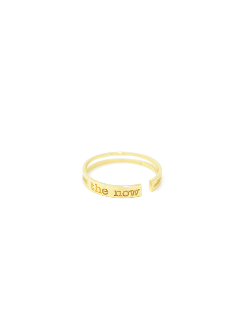 jewelry for this moment. the now.  a prominent 14K gold bar ring embossed with the now logo serves as a playful reminder to always raise the bar.