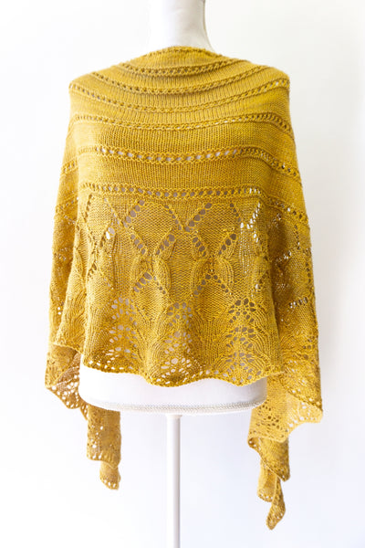 lace shawl knitted with semi-solid tonal hand-dyed yarn