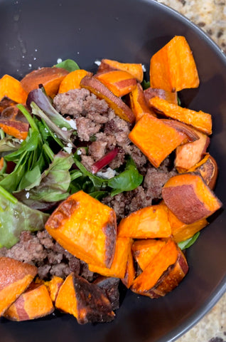 Sweet potatoes, ground beef, goat cheese, greens dinner bowl