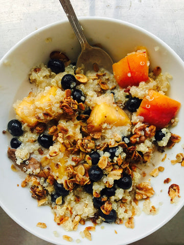 Quinoa FitChick Breakfast Bowl with blueberries and peaches