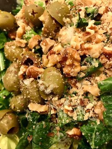 Spinach salad with Castelvetrano olives, chopped walnuts, manchego cheese
