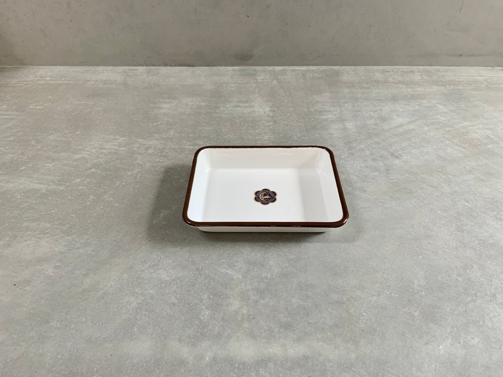 White tray with brown rim