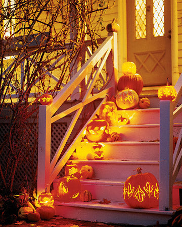 Leaf Carved Pumpkins Displayed as Lanterns from Martha Stewart. halloween decorating