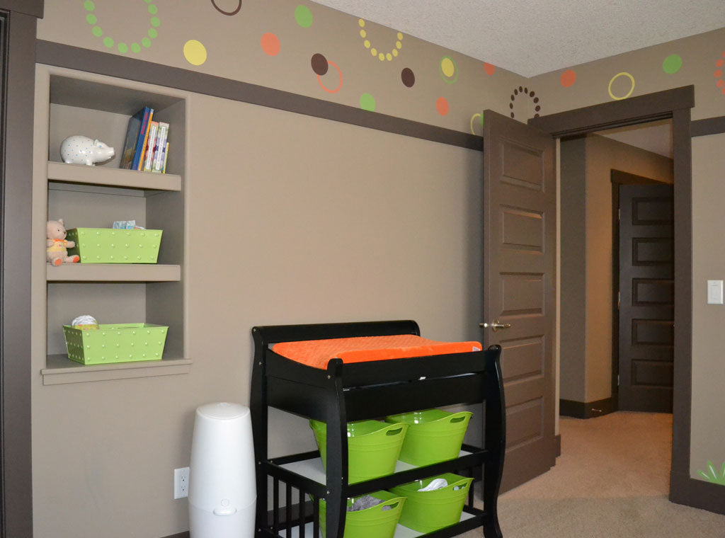 An Orange and Green Baby Room with Polka Dot Ceiling Border