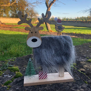 WOODEN REINDEER WITH FUR BODY AND ROBIN