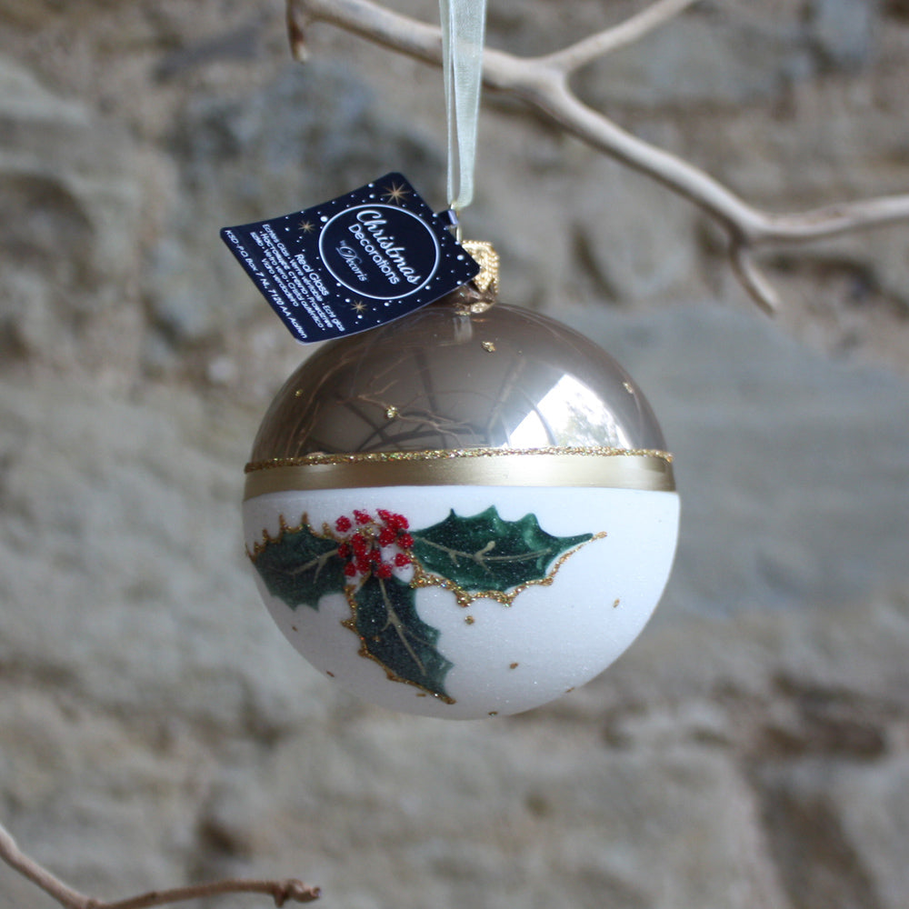 Glass bauble with holly