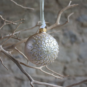 Champagne glass bauble with star burst glitter lines