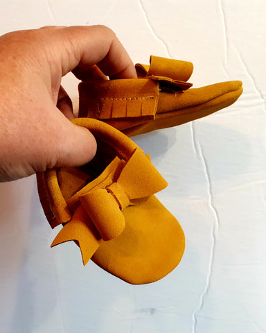 Mustard suede moccs with bow