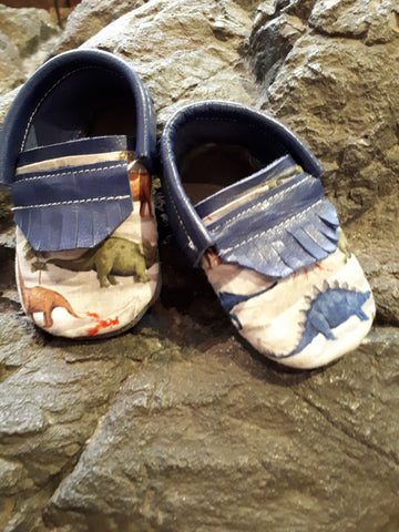 Blue leather with short fringe and dinosaur toe toppers.