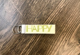 happy keychains