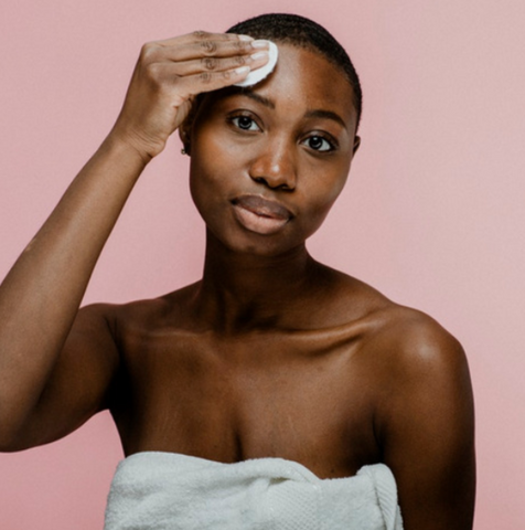black woman, washing face