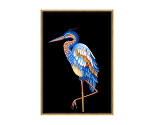 Heron II is a print by Jackie Von Tobel with a prowling bird on a black background in bright blue, yellow, and pale orange hues that was created for LeftBank Art where Jackie is a bestselling artist.