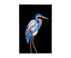 Heron I is a print by Jackie Von Tobel with a prowling bird on a black background in bright blue, yellow, and pale orange hues that was created for LeftBank Art where Jackie is a bestselling artist.