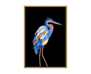 Heron I is a print by Jackie Von Tobel with a prowling bird on a black background in bright blue, yellow, and pale orange hues, the piece of wall art framed in black and gold.