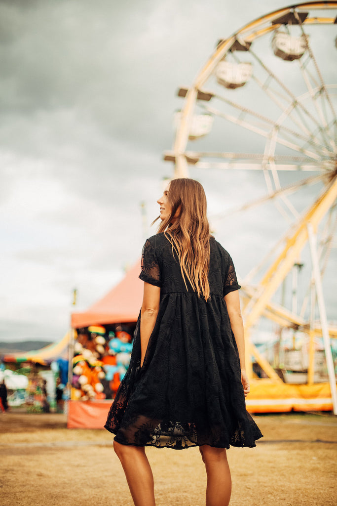 The black Ellie dress worn at a carnival