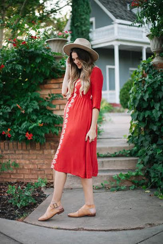 The red Cocinera Dress, a maternity friendly dress by Piper & Scoot