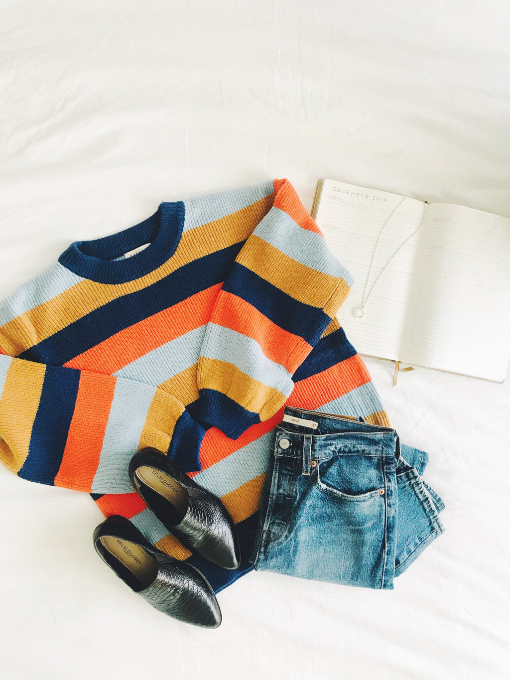The Cut Striped Sweater in Navy + Rust Multi
