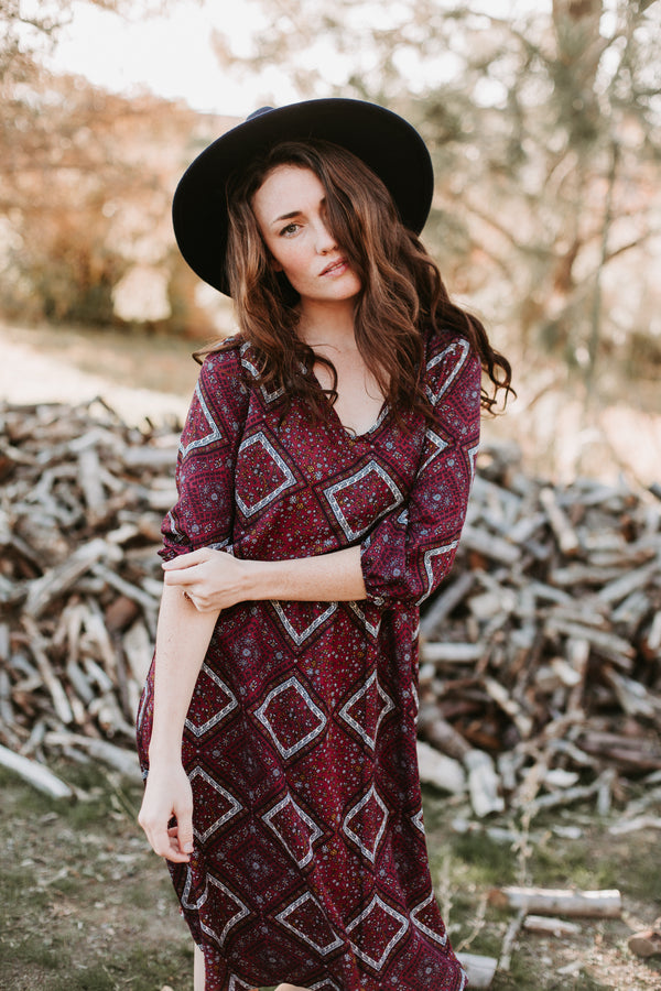 The Winona Patterned Bib Dress in Plum