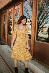 The Afton Floral Wrap Dress in Mustard