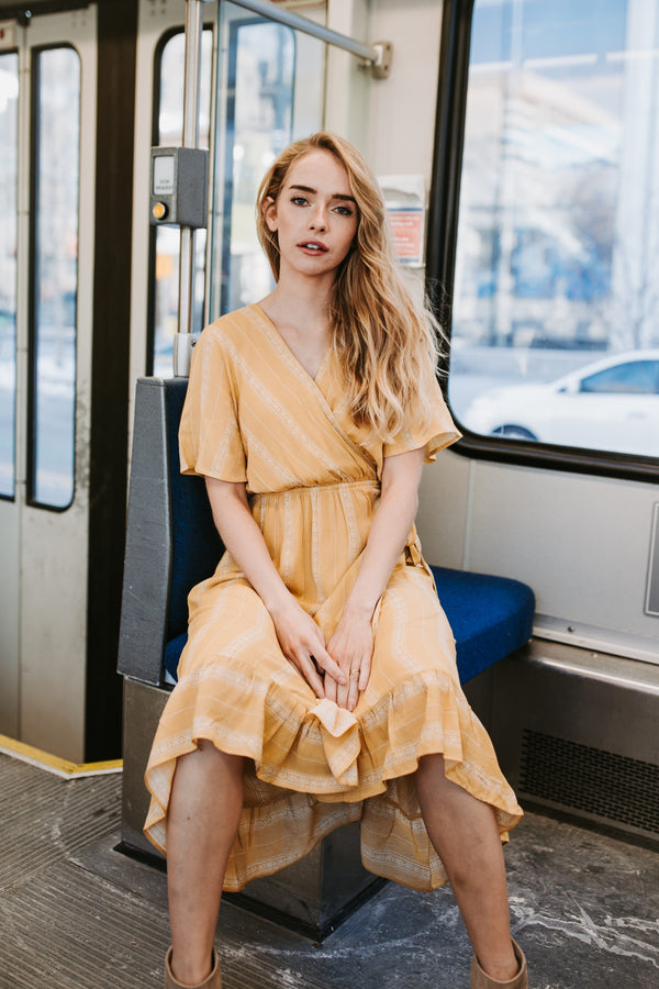 The Kristi Patterned Wrap Dress in Mustard