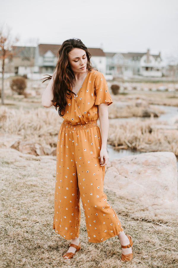 The Jubilee Floral Jumpsuit in Mustard