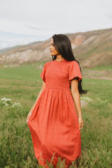 The Herb Smocked High Neck Maxi Dress in Brick