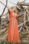 The Walsh Embroidered Maxi Dress in Rust, lifestyle shoot; front view