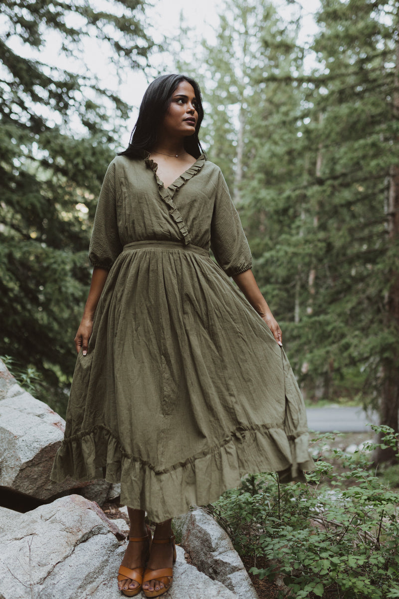 Piper & Scoot: The Prodigy Cotton Midi Dress in Olive, lifestyle shoot; front view