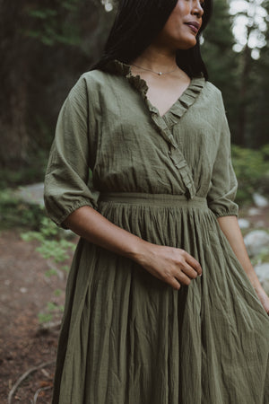 Piper & Scoot: The Prodigy Cotton Midi Dress in Olive, lifestyle shoot; closer up front view