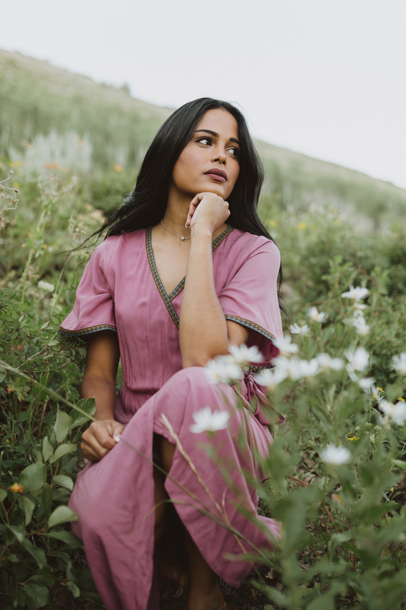 Piper & Scoot: The Presley Detail Wrap Dress in Deep Mauve, lifestyle shoot; kneeling front view