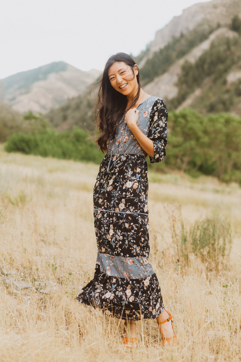 The Haskell Floral Contrast Maxi Dress in Black, lifestyle shoot; front view