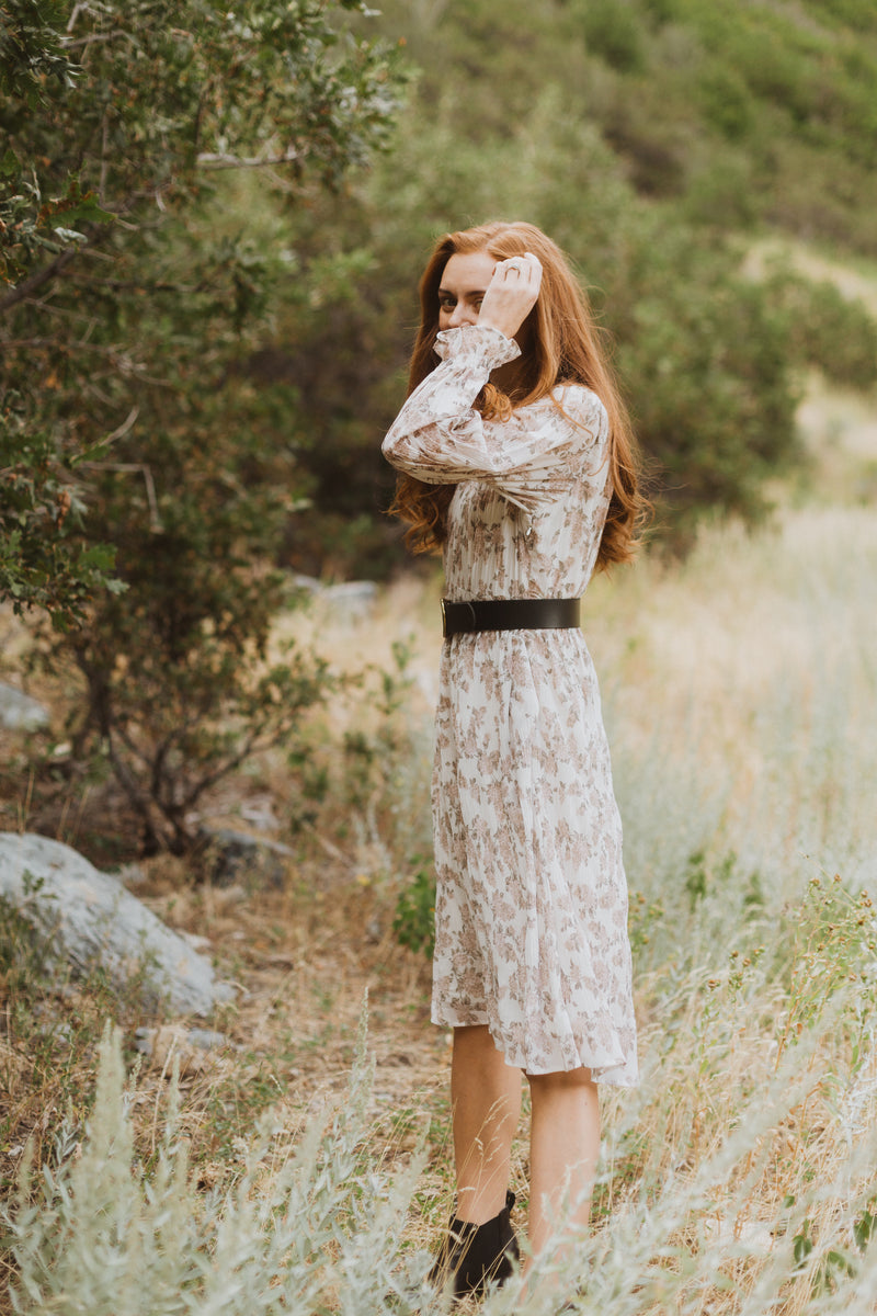 The Silvan Floral Pleated Dress in Ivory, lifestyle shoot; side view