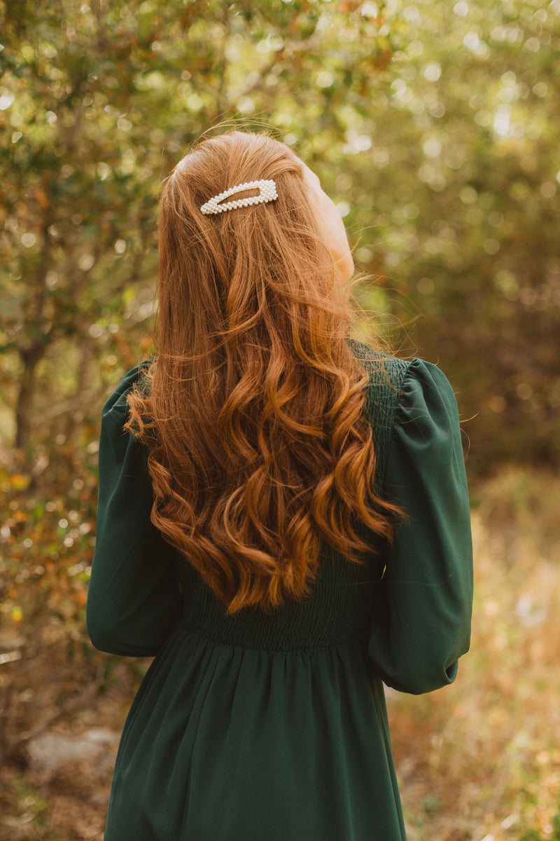 The Ezra Smocked Midi Dress in Hunter Green, lifestyle shoot; closer up back view