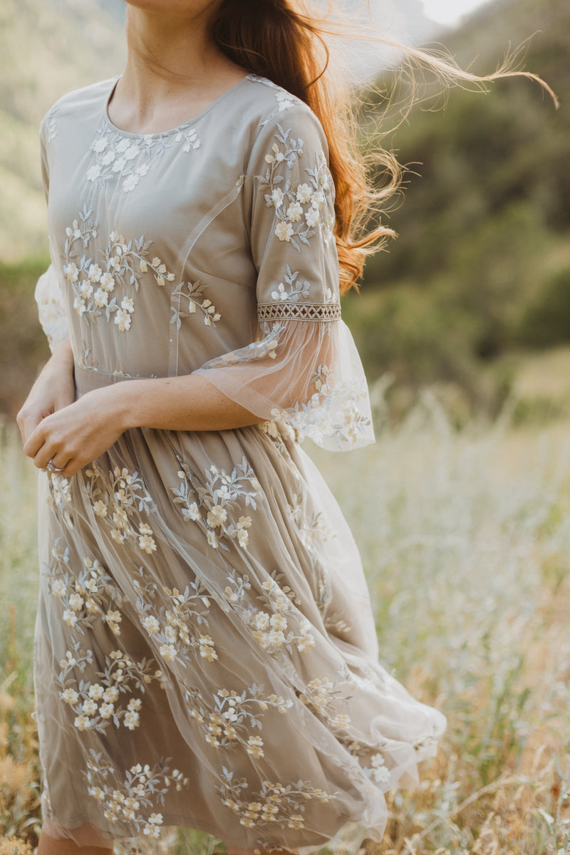 The Imagine Lace Dress in Grey, lifestyle shoot; closer up front view