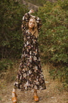 The Major Floral Wrap Maxi Dress in Black, lifestyle shoot; front view