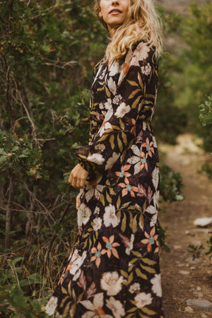 The Major Floral Wrap Maxi Dress in Black, lifestyle shoot; side view