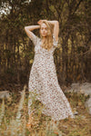The Mighty Leopard Maxi Dress in Ivory, lifestyle shoot; front view