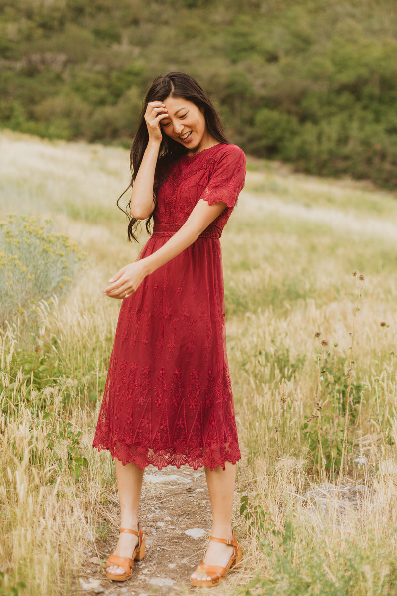 The Simon Lace Midi Dress in Plum, lifestyle shoot; front view