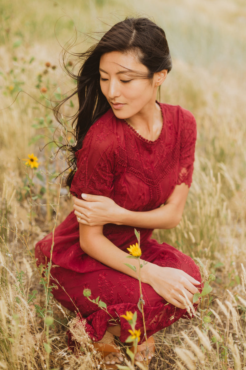 The Simon Lace Midi Dress in Plum, lifestyle shoot; closer up kneeling front view