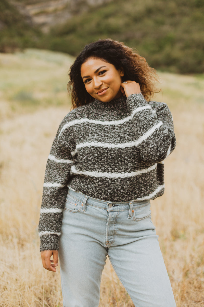 The Her Striped Sweater in Heathered Charcoal- lifestyle shoot; front view