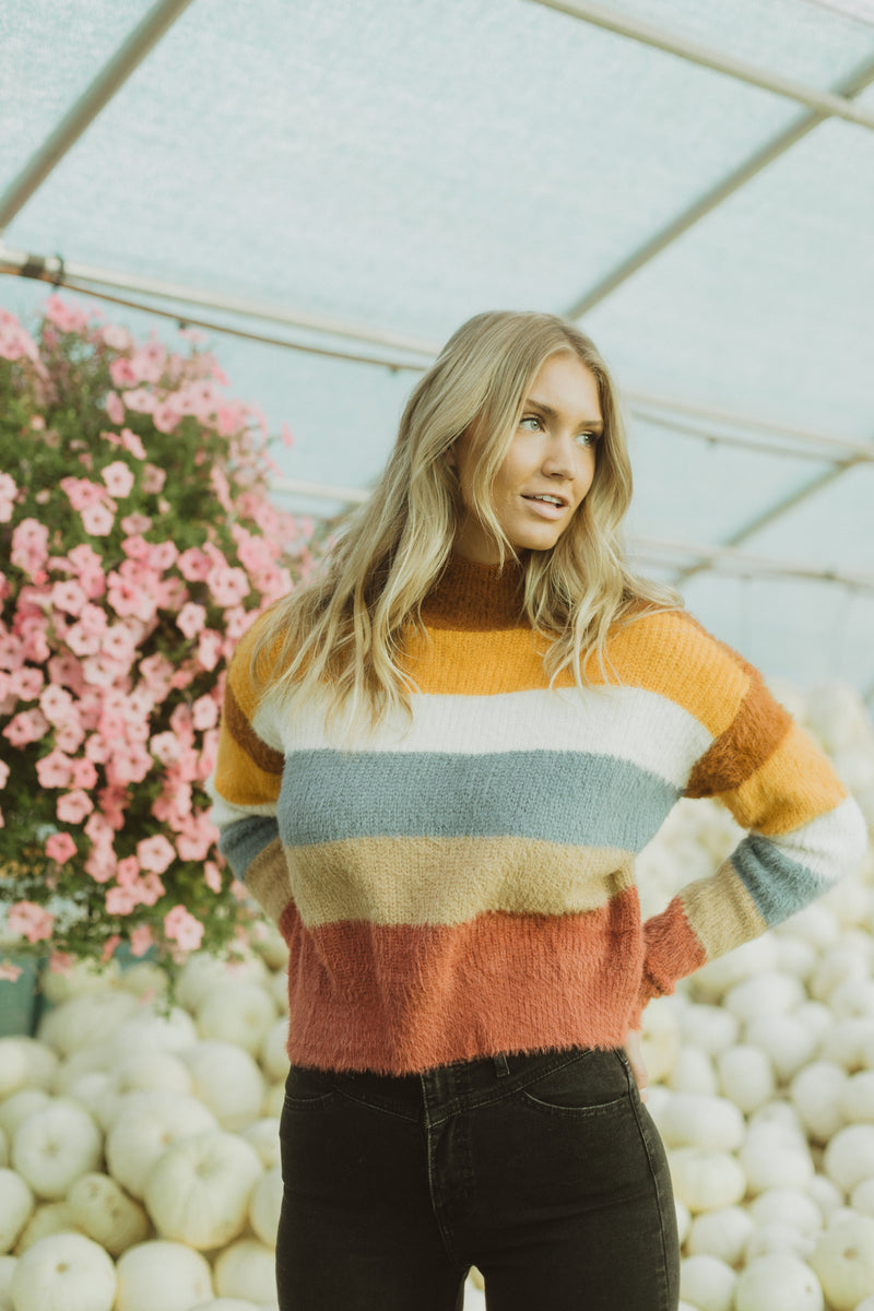 The Maryville Striped Mock Neck Sweater in Multi, lifestyle shoot; front view