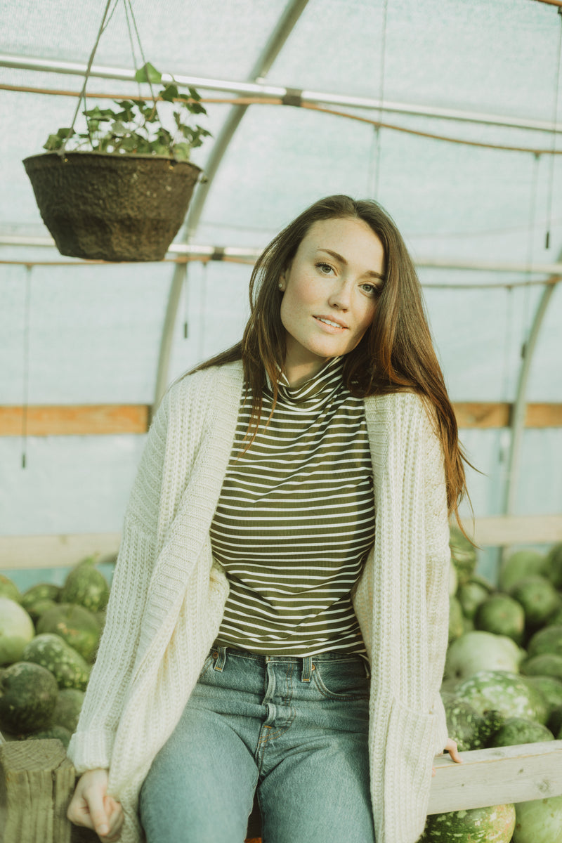 The Carey Knit Chunky Cardigan in Cream, lifestyle shoot; front view