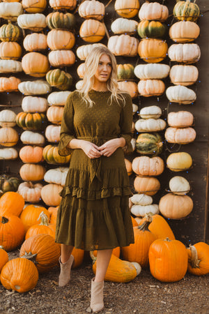 The Hallie Swiss Dot Ruffle Dress in Moss, lifestyle shoot; front view