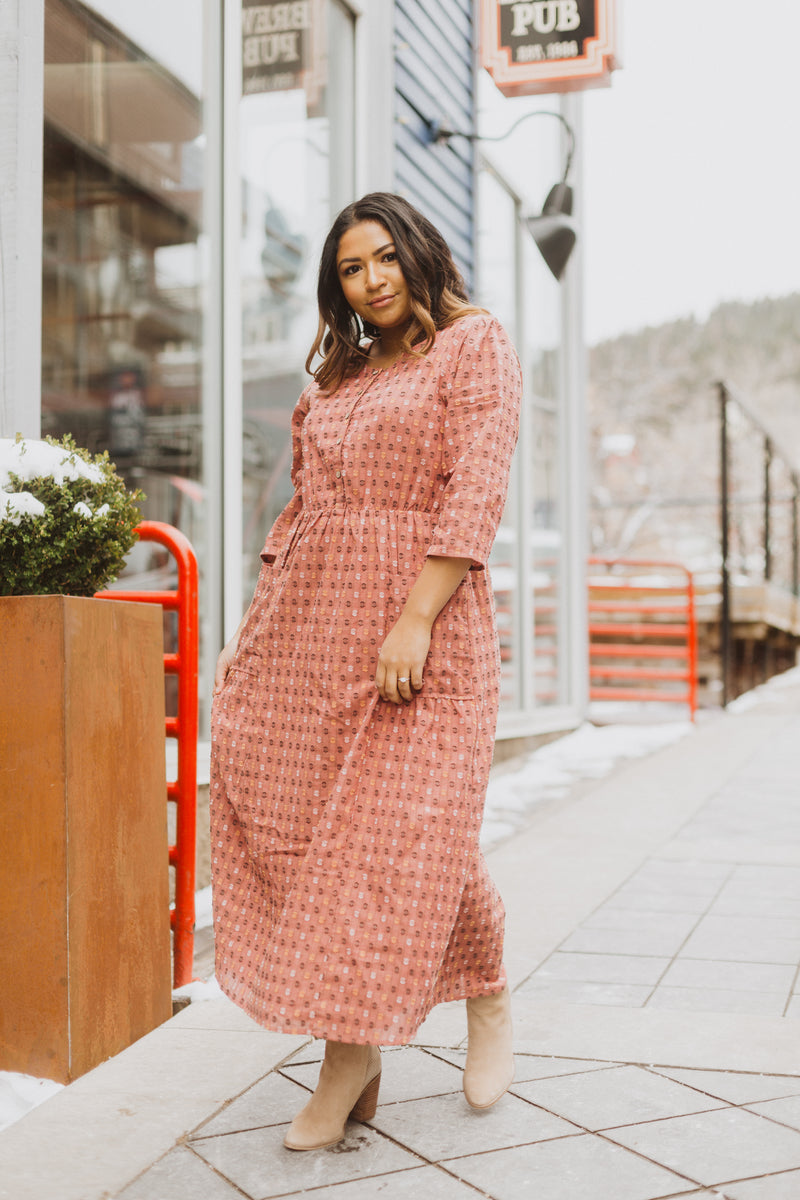 The Vivid Check Tiered Maxi Dress in Mauve, lifestyle shoot; front view