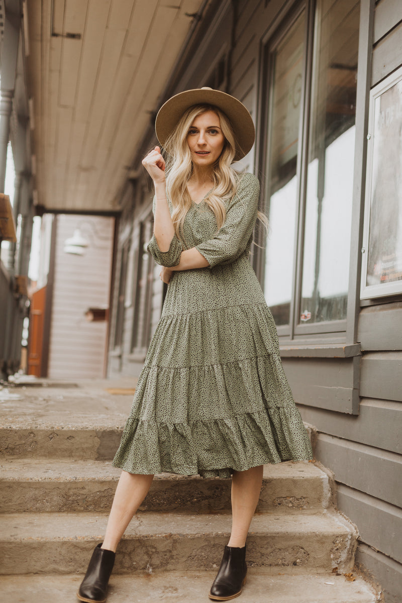 The Nawel Dot Tiered Dress in Sage, lifestyle shoot; front view
