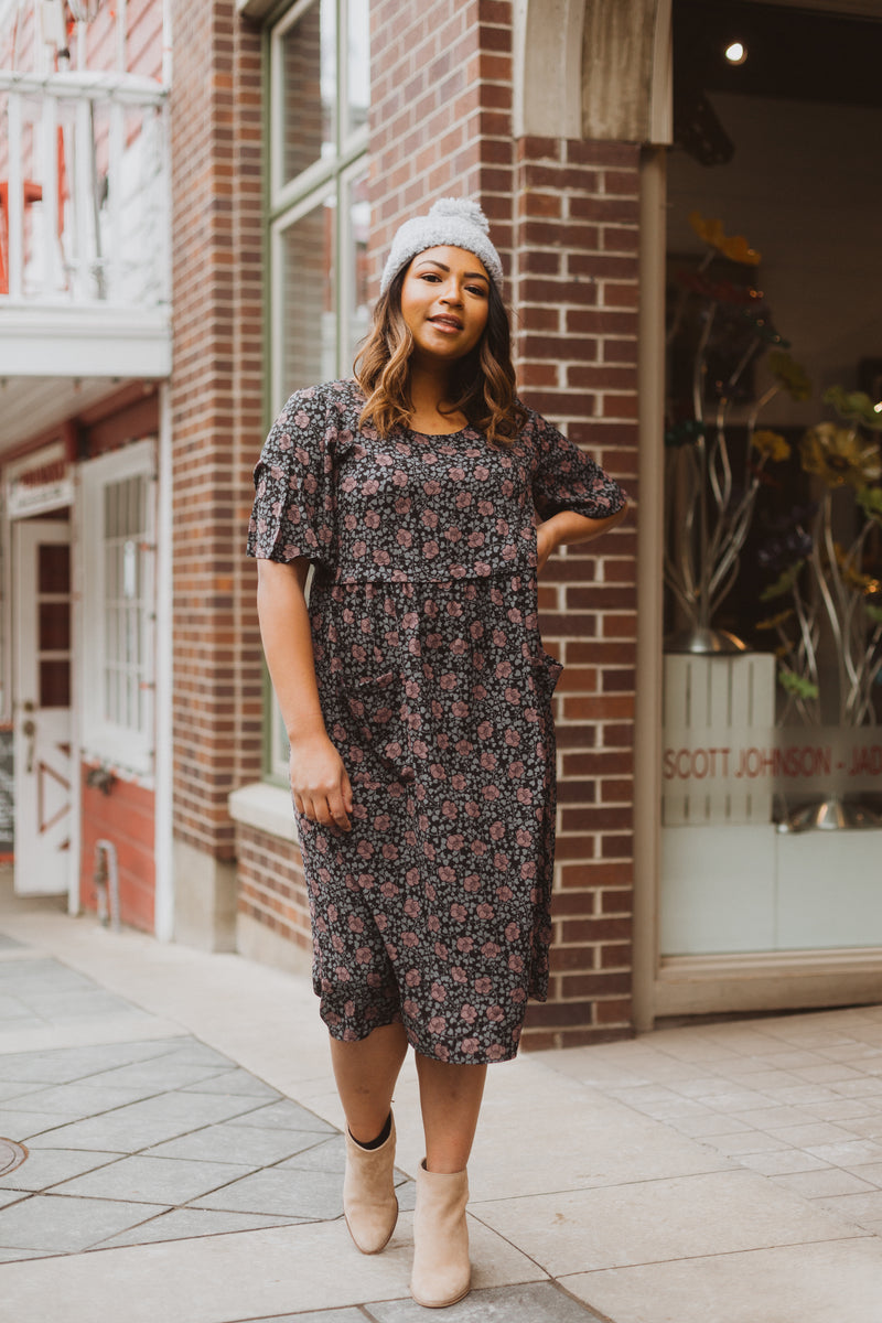 Piper & Scoot: The Jack Floral Bib Dress in Black, lifestyle shoot; front view