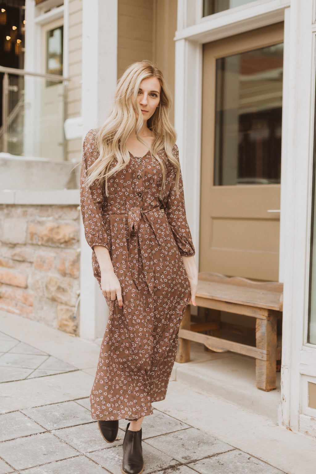 The Folk Floral Tie Maxi Dress in Coco, lifestyle shoot; front view